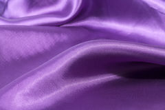 Silk background, texture of violet shiny fabric Stock Photography