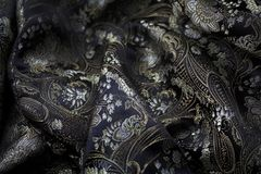 Silk black and gold fabrick Royalty Free Stock Photography