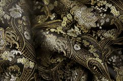 Silk black and gold fabrick stock photos