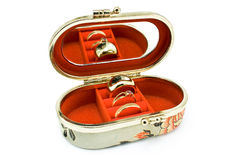 Silk box with golden rings Stock Photography