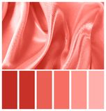 Silk cloth folds as background. Palette with coral color. Silk cloth folds as background. Palette with living coral color stock photo