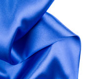 Silk cloth with folds of dark blue. Stock Images