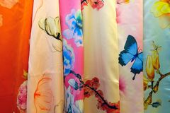 Silk clothes. The background of embroidered silk clothes stock images