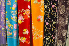 Silk clothes. The background of embroidered silk clothes Stock Photo