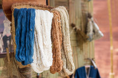 Silk color in basket. Silk for handmade fabric fashion dress in basket to show lifstyle of agricuture life rural of northern thailand Royalty Free Stock Photography