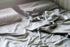 Silk crumpled linen on the bed Royalty Free Stock Photo