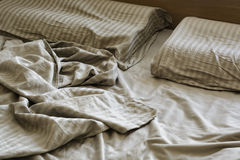 Silk crumpled linen on the bed Royalty Free Stock Images