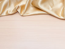 Silk draped on wood Royalty Free Stock Photos