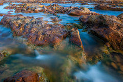 Silk effect on the water in the river Tinto in Huelva. Silk effect on the water in the river Tinto with stones of color bronze, near the village of Niebla, in Stock Photography