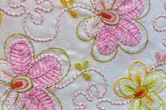 Silk embroidery flowers on white background Stock Photo