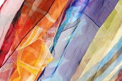 silk färgrika scarfs för bakgrund Arkivbild