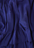 Silk fabric closeup. Closeup detail of a blue silk ruffle dress Stock Photos