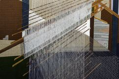 Silk fabric, hand weaving process in Thailand Royalty Free Stock Image