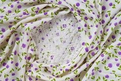 Silk fabric tapestry with floral texture and white lace of crochet napkins Stock Images