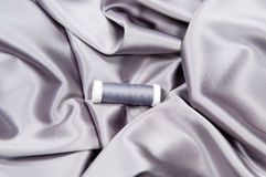 Silk fabric   and thread Stock Images