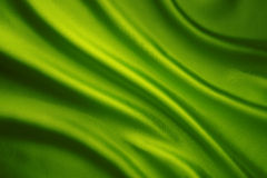 Silk Fabric Waves Background, Abstract Green Satin Cloth Stock Image