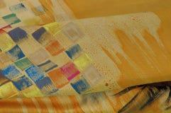 Silk fabrics. Beautiful hand painted silk scarf Stock Image