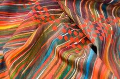 Silk fabrics. Hand painted on dyed silk Stock Image
