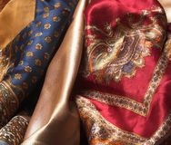 Silk fabrics. Red< yellow and blue silk fabrics with easten patternr stock photo