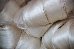 Silk fibres. White silk fibres close-up. Illustration about silk production technology royalty free stock image