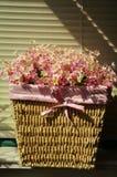 Silk flower in rattan basket Stock Photography