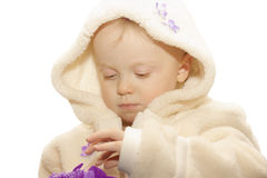 Silk flowers 1. Cute little girl playing with silk flowers, on white, clipping path Royalty Free Stock Photo