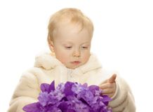 Silk flowers. Little girl with lilac silk flowers on white background Royalty Free Stock Photo
