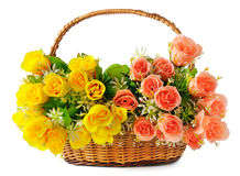 Silk flowers in a basket Royalty Free Stock Images