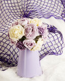 Silk flowers display Stock Images