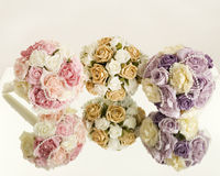 Silk flowers display on mirror Royalty Free Stock Photo