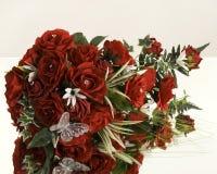 Silk flowers display on mirror Royalty Free Stock Image