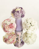 Silk flowers display on mirror Stock Images