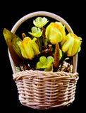 Silk flowers in wicker basket Royalty Free Stock Images