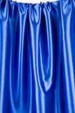 Silk with folds of dark blue texture. Stock Photo