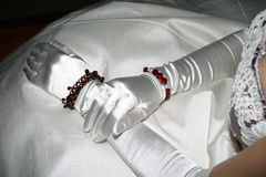 Silk Gloves. On the brides lap stock image