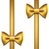 Silk gold ribbon with a bow Royalty Free Stock Image
