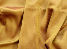 Silk golden fabric texture close up. Stock Photography