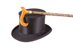 Silk hat and walking stick. Black silk hat and walking stick isolated on a white background Royalty Free Stock Photo