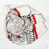 Silk head scarf on concrete plate Royalty Free Stock Image