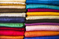 Silk heap. Multicolored silk heap on a market in Asia stock photography