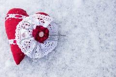 Silk heart handmade on the snow Royalty Free Stock Photos