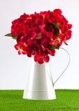 Silk hydrangea in jug Royalty Free Stock Photo