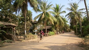 SILK ISLAND,CAMBODIA - MARCH 2014: tranquil village houses,rural life stock footage