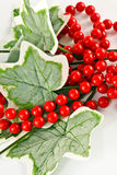 Silk Ivy Leaves and Red Beads Royalty Free Stock Images
