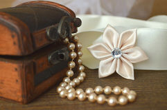 Silk kanzashi flower and pearls Stock Photos