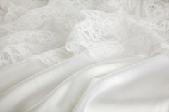 Silk and lace wedding dress background. Background of white silk and lace wedding dress Royalty Free Stock Photo