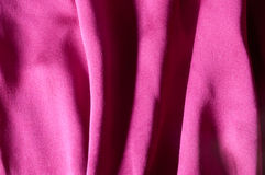 Silk magenta, deep folds. Close up of red silk textile, deep folds Stock Photography