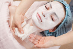 Silk mask applying, facial beauty treatment Royalty Free Stock Photos