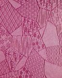Silk Mauve Kimono Background. A detail shot of a vintage dark pink silk kimono. It is intricately brocaded with several traditional Japanese motifs, including Royalty Free Stock Photos
