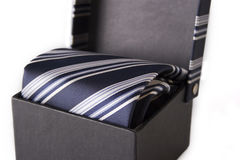 Silk necktie with box. Isolated on the white background Royalty Free Stock Images